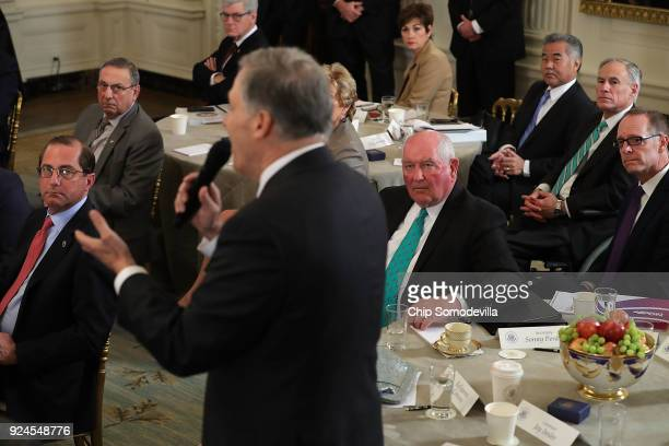 Fellow governors listen to Washington Governor Jay Inslee speak during a business session hosted by US President Donald Trump in the State Dining...