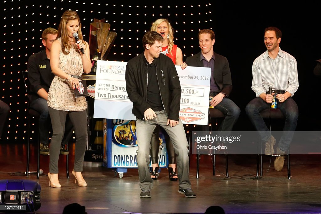 Fellow NASCAR drivers watch as Denny Hamlin, driver of the #11 FedEx Toyota, dances on stage during NASCAR After The Lap at PH Live at Planet Hollywood Resort & Casino on November 29, 2012 in Las Vegas, Nevada.