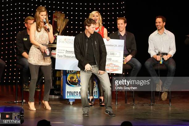 Fellow NASCAR drivers watch as Denny Hamlin driver of the FedEx Toyota dances on stage during NASCAR After The Lap at PH Live at Planet Hollywood...