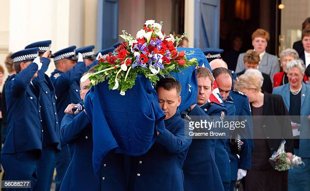Fellow Police officers carry the casket from the Cathedral of the holy spirit Broadway Palmerston North after the funeral of murdered police officer...