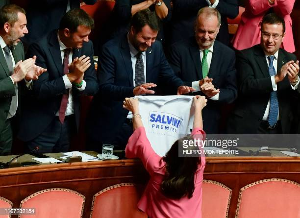 A fellow senator hands to Head of the farright Northern League party current Italian Senator and former Interior Minister Matteo Salvini a jersey...