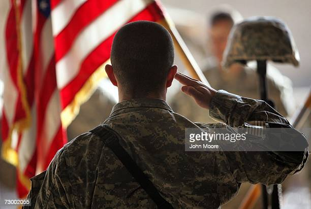 A fellow soldier honors slain US Army PFC Ming Sun age 20 and a naturalized American citizen at a memorial ceremony January 15 2007 in Ramadi in...