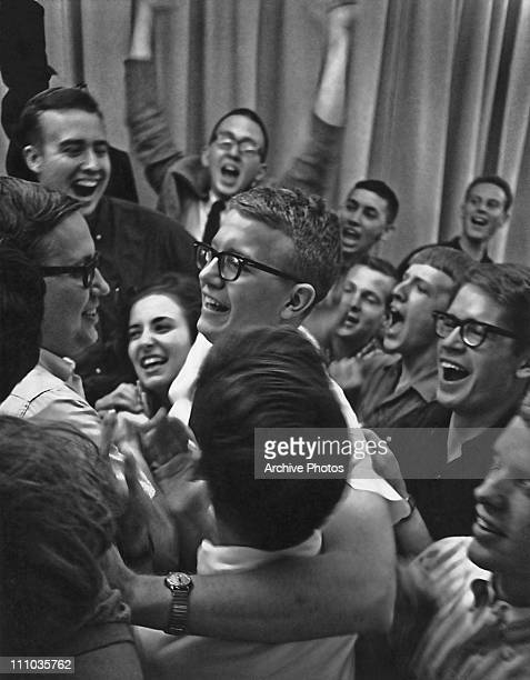 Fellow students congratulate Leo Schrey on his election as President of the student body at the University of Kansas circa 1960