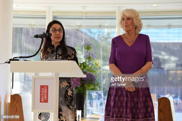 Fellow Tahmima Anam speaks as Camilla Duchess of Cornwall looks on at The Royal Society of Literature '40 Under 40' fellow induction at The British...