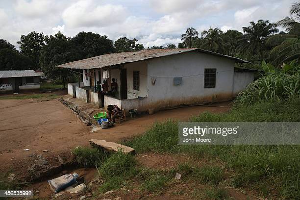 Fellow tenants sit at the home where Eric Duncan the first Ebola patient to develop symptoms in the United States rented a room on October 2 2014 in...