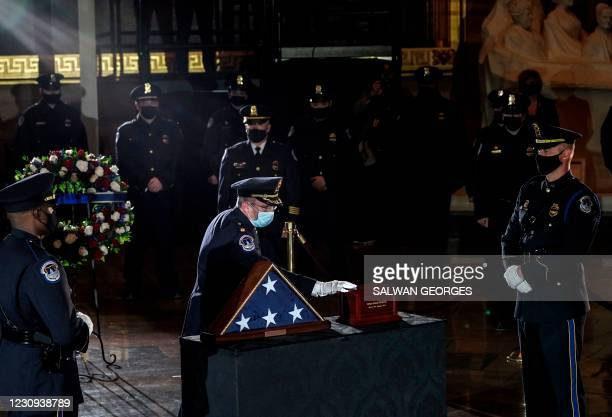 Fellow US Capitol Police Officer pays his respects to US Capitol Police Officer Brian Sicknick, as he lies in honor in the Capitol Rotunda in...