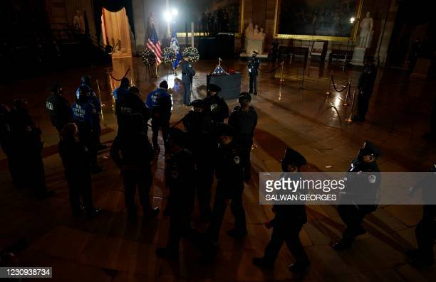 Fellow US Capitol Police Officers pay their respects to US Capitol Police Officer Brian Sicknick, as he lies in honor in the Capitol Rotunda in...