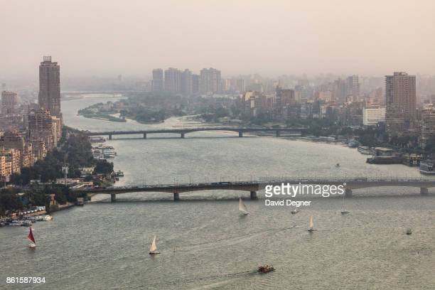 September 24: Felluca boats and a ferry sale on the Nile near the Cairo University Bridge on September 24, 2017 in Cairo, Egypt. Overview photos of...
