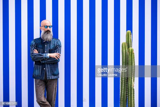 Felpastyle wearing striped denim shirt and brown pants is seen during the 94th Pitti Immagine Uomo at Fortezza Da Basso on June 14 2018 in Florence...