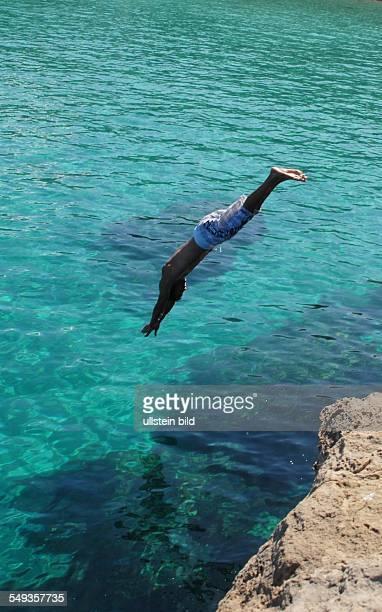 Felsenspringer an der Strandbucht Cala Conta auf Ibiza