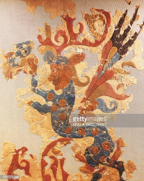 Felt decoration depicting a fenix.
