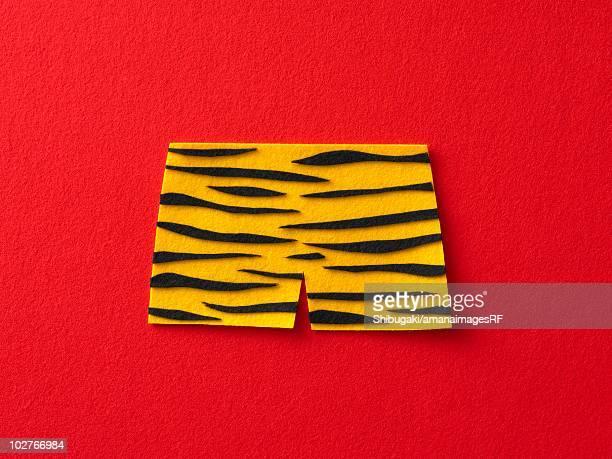 Felt tiger print pants, red background