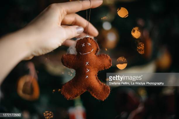 felted ginger-man christmas tree ornament - tradition stock pictures, royalty-free photos & images