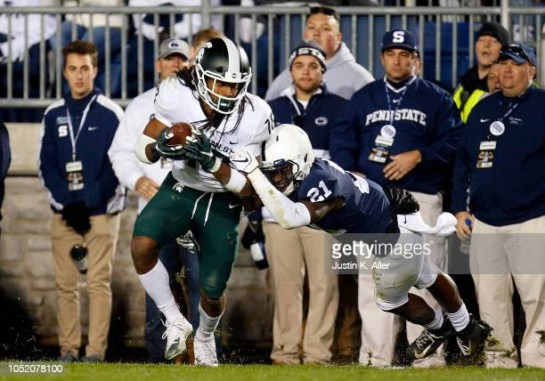 Felton Davis III of the Michigan State Spartans catches a 25 yard touchdown pass in the fourth quarter against Amani Oruwariye of the Penn State...