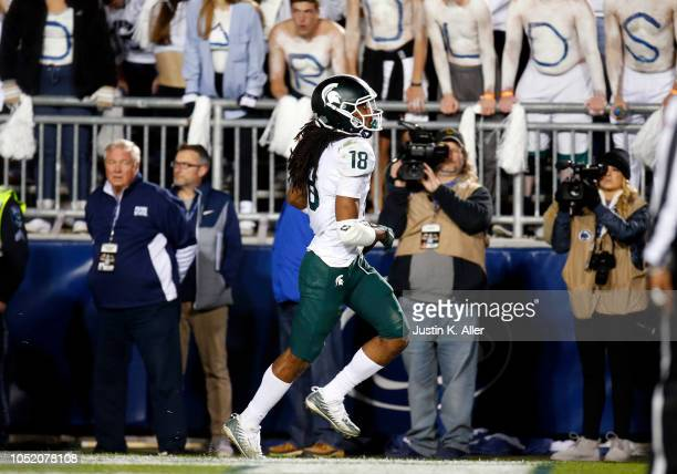 Felton Davis III of the Michigan State Spartans celebrates after catching a 25 yard touchdown pass in the fourth quarter against Amani Oruwariye of...