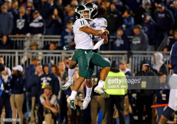 Felton Davis III of the Michigan State Spartans celebrates with Connor Heyward of the Michigan State Spartans after catching a 25 yard touchdown pass...