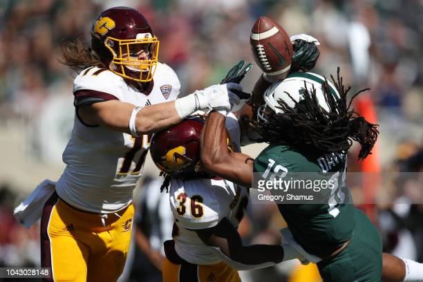 Felton Davis III of the Michigan State Spartans tries to come up with a first half pass next to Tyjuan Swain of the Central Michigan Chippewas at...