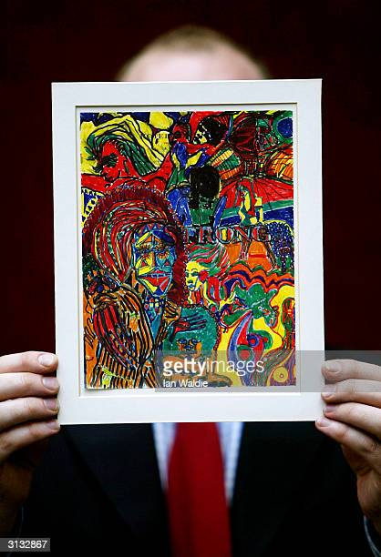 A felttip drawing by Beatles star John Lennon called Strong is prepared for auction March 26 2004 in London The drawing believed to be executed by...