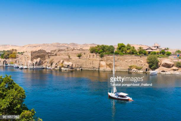 felucca boat on river nile at aswan, egypt - ナイル川 ストックフォトと画像