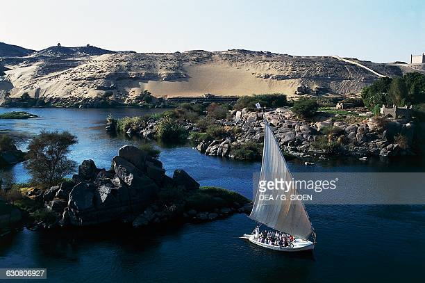 Felucca traditional wooden sailing boat on the Nile near Aswan Egypt