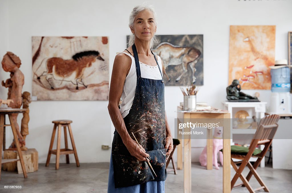A femail artist in her studio : Stock Photo