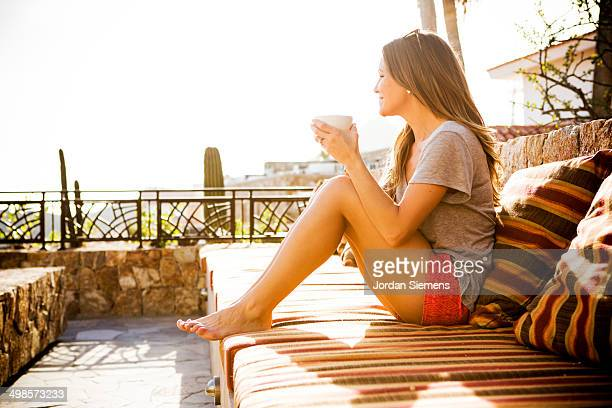 Femal drinking coffee in the morning.