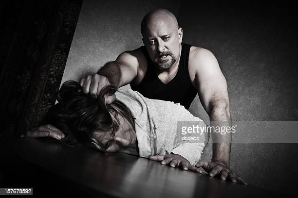 female abuse victim being grabbed by man - battered woman stock pictures, royalty-free photos & images