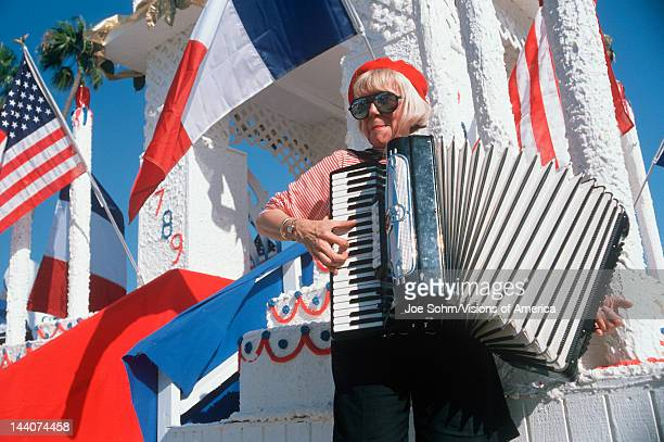 A female accordion player performing at the French Revolution Bicentennial Celebration Hollywood Park CA