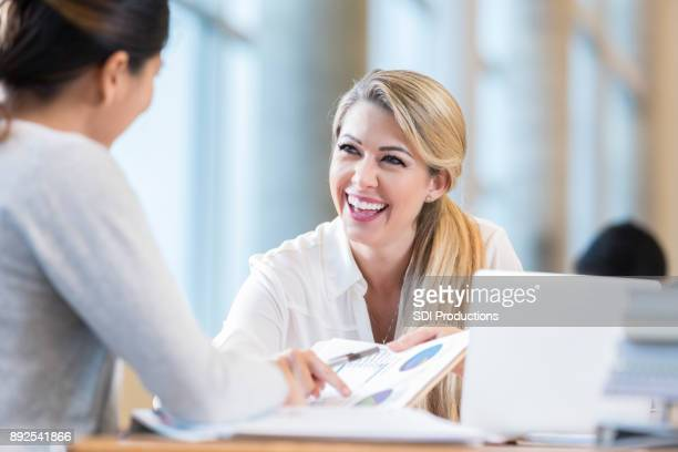 Female accountants discuss financial reports