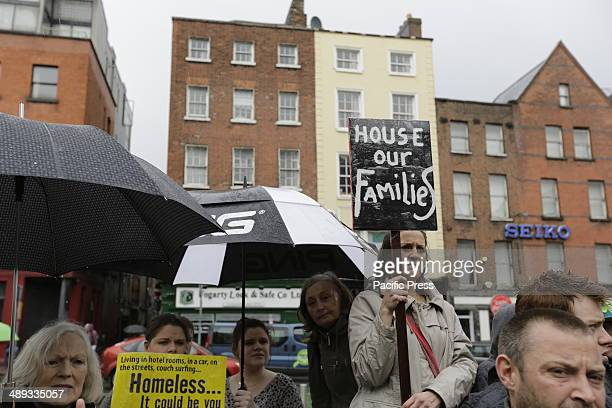 STREET DUBLIN LEINSTER IRELAND A female activist holds a sign that reads 'House our families' at the protest against homelessness where activists...