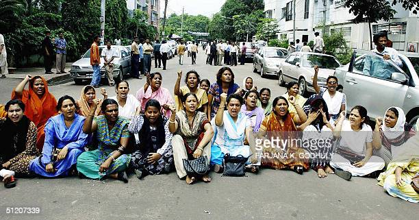 Female activists from the student wing of Bangladeshi opposition party the Awami League shout antigovernment slogans during a demonstration in Dhaka...