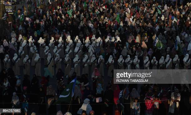 TOPSHOT Female activists of JamaateIslami Pakistan gather during an antiUS and antiIsrael protest rally in Karachi on December 17 following US...