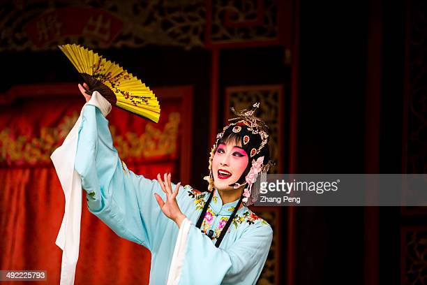 A female actress is playing Mudanting on the stage Mudanting is a famous work of Kunqu also known as Kunju Kun opera or Kunqu Opera and is one of the...