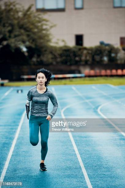 Female adaptive athlete training at a running track