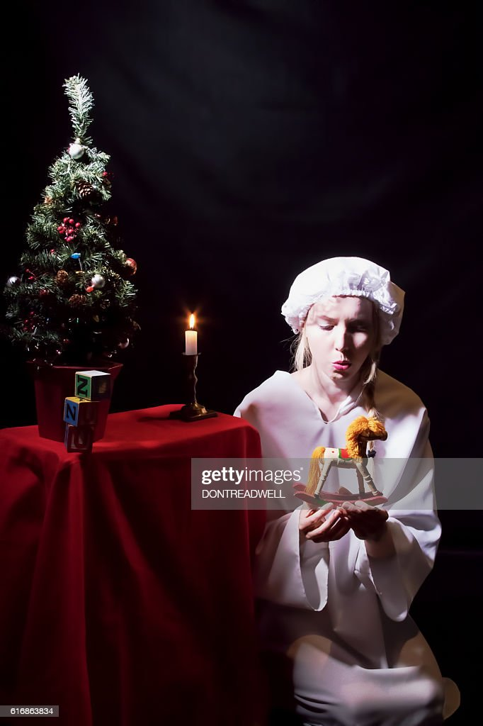 Female Adult Is Pleased At  Her Christmas Gifts : Stock Photo