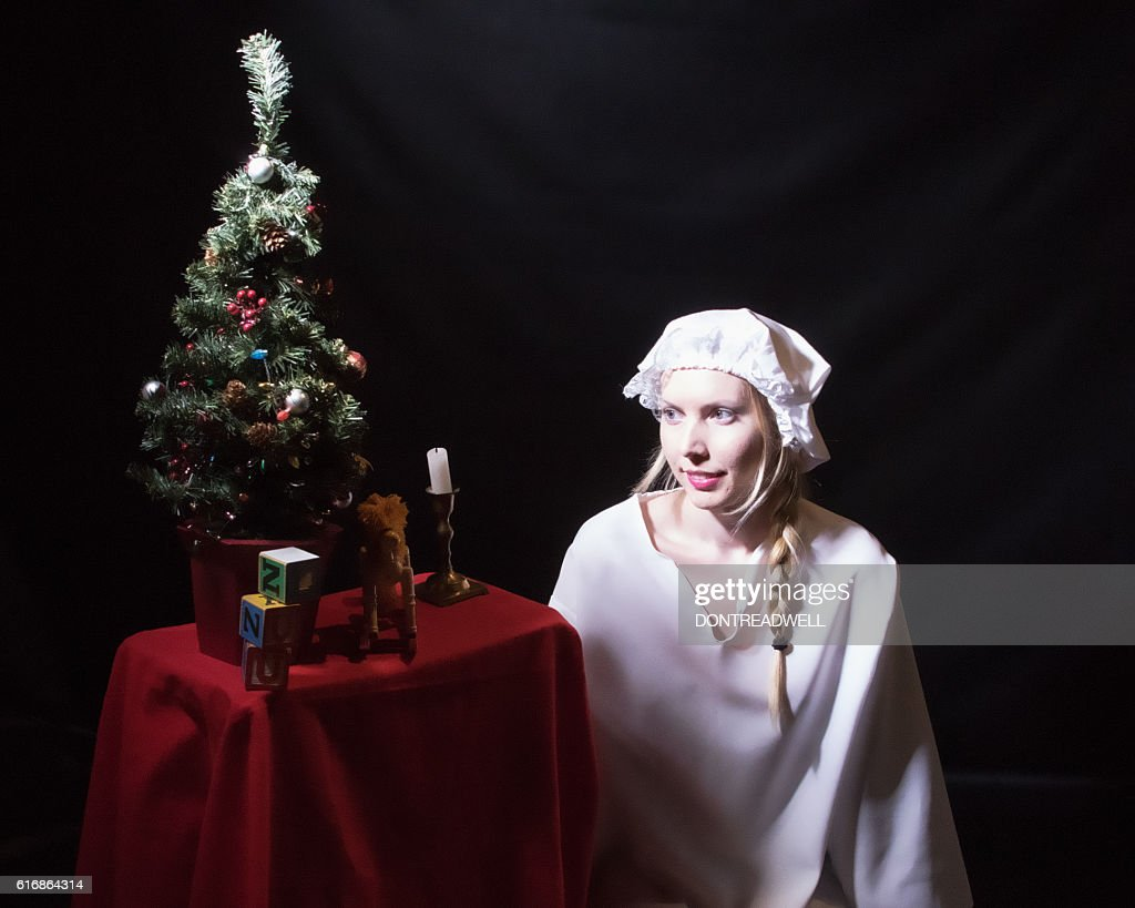 Female Adult Looking At Her Christmas Display : Stock Photo