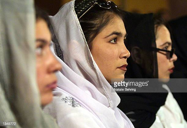 Female Afghan college students watch the taping of Afghanistan's most popular game show 'Test Your Brain' or 'Azmonga Zehni' in Dari August 21 2002...