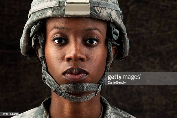 female african american soldier series: against dark brown background - army soldier stock photos and pictures