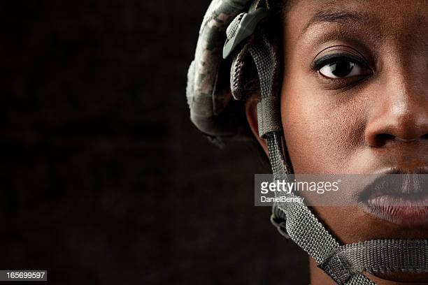female african american soldier series: against dark brown background - warrior person stock photos and pictures