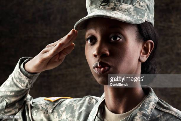 female african american soldier series: against dark brown background - saluting stock pictures, royalty-free photos & images