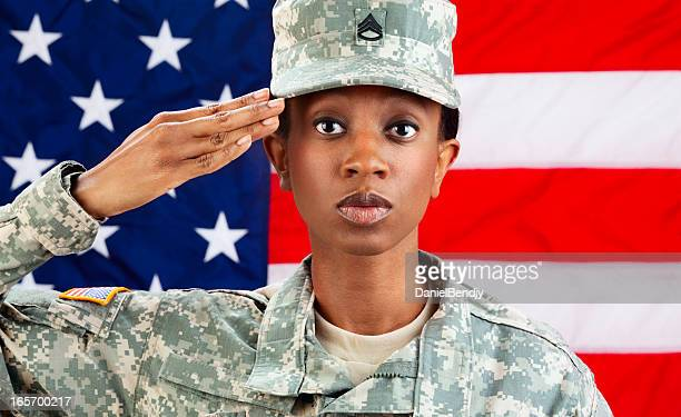 female african american soldier series: saluting aganist usa flag - saluting stock pictures, royalty-free photos & images
