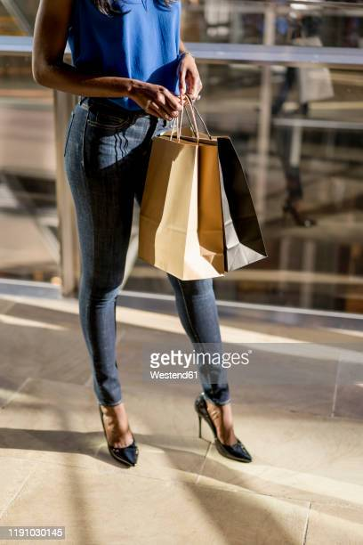 female afro-american with shopping bags in a mall - high heels stock pictures, royalty-free photos & images