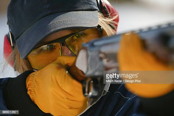 Female Aims While Target Shooting Skeet