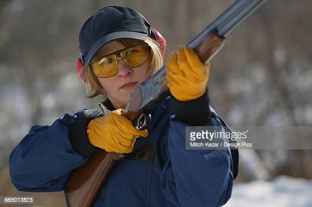 Female Aims While Target Shooting Skeet