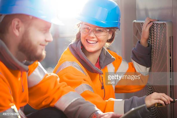 female air conditioning technician with her supervisor - ventilator stock pictures, royalty-free photos & images