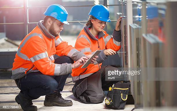 female air conditioning technician with her supervisor
