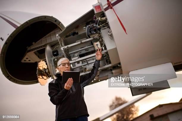 Female aircraft mechanic