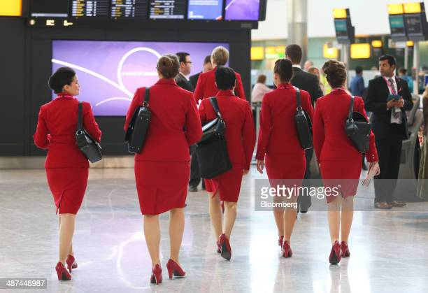 Female airline staff from Virgin Atlantic Airways Ltd walk across the airport departures hall during a test day ahead of opening at Heathrow...