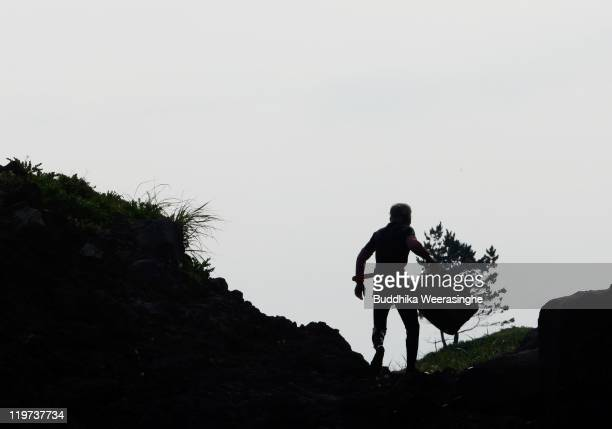 A female Ama diver carries her catch of sea urchins at Fukura Beach on July 24 2011 in Fukui Japan In Fukui prefecture sea urchin fishing is allowed...