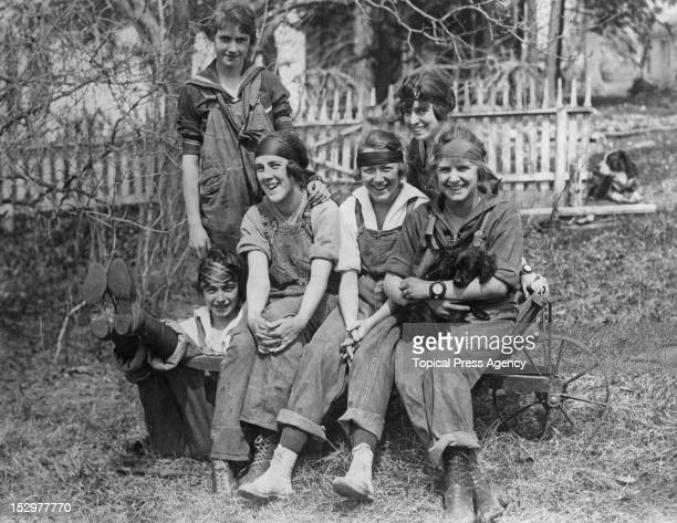 Female American college students at a farm where they are working as replacements for men called up to the military in World War I USA May 1918